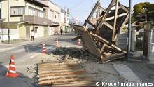 Strong quake in northeastern Japan The fallen gate of a house is seen on a street in Koori, Fukushima Prefecture, on Feb. 14, 2021, after an earthquake with a magnitude of 7.3 struck northeastern Japan late on Feb. 13. PUBLICATIONxINxGERxSUIxAUTxHUNxONLY
