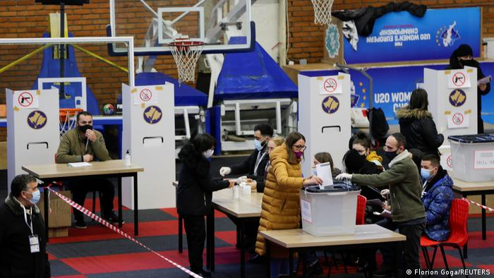 Voters cast their ballots during parliamentary elections in Pristina
