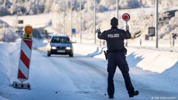 An officer of the Federal Police stops a car driver for a control at the German-Czech border near Zinnwald, eastern Germany