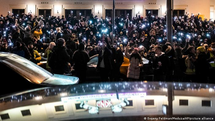 A crowd shine their cellphone flashlights during a protest against the jailing of opposition leader Alexei Navalny in Moscow (Evgeny Feldman/Meduza via AP)