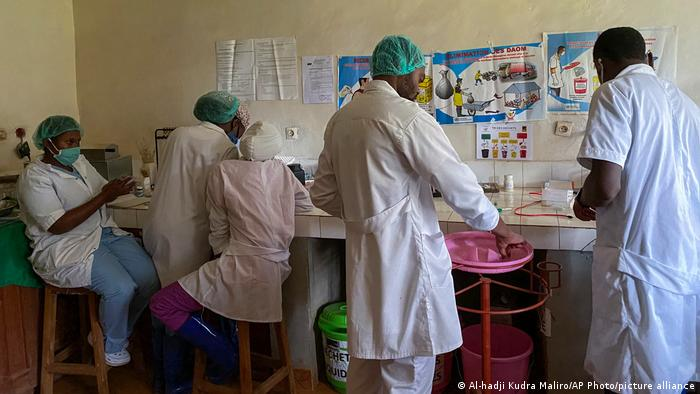 Medical workers prepare medicine in a hospital in the Congo