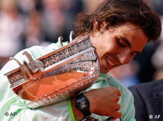 Nadal holds his cup at the French Open