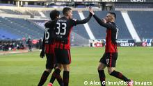 FRANKFURT AM MAIN, GERMANY - FEBRUARY 14: Andre Silva of Eintracht Frankfurt celebrates with teammates Daichi Kamada (L) and Filip Kostic (R) after scoring their team's first goal during the Bundesliga match between Eintracht Frankfurt and 1. FC Koeln at Deutsche Bank Park on February 14, 2021 in Frankfurt am Main, Germany. Sporting stadiums around Germany remain under strict restrictions due to the Coronavirus Pandemic as Government social distancing laws prohibit fans inside venues resulting in games being played behind closed doors. (Photo by Alex Grimm/Getty Images)