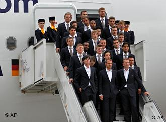 The Germany squad for the 2010 World Cup poses on the steps of the plane before setting off for South Africa