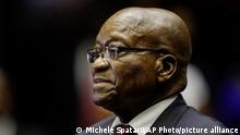 Former South African President Jacob Zuma, in the High Court in Pietermaritzburg, South Africa, Tuesday, Oct. 15, 2019. Zuma faces charges of corruption, money laundering and racketeering related to a 1999 arms deal. Court proceedings for former South African president Jacob Zuma have been pushed back to Feb. 4 as his legal team says it will appeal a ruling dismissing its attempt to halt prosecution for good. (Michele Spatari/Pool via AP)