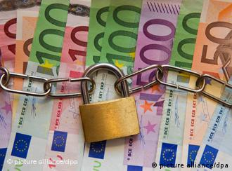 Euro notes under a chain and padlock