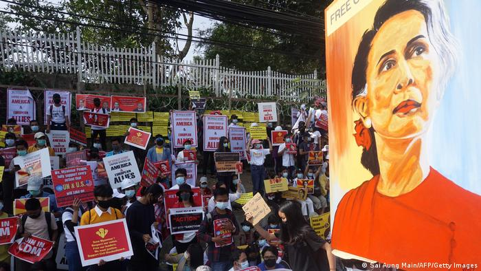 Protesters display a poster with an image of detained Myanmar leader Aung Saan Suu Kyi