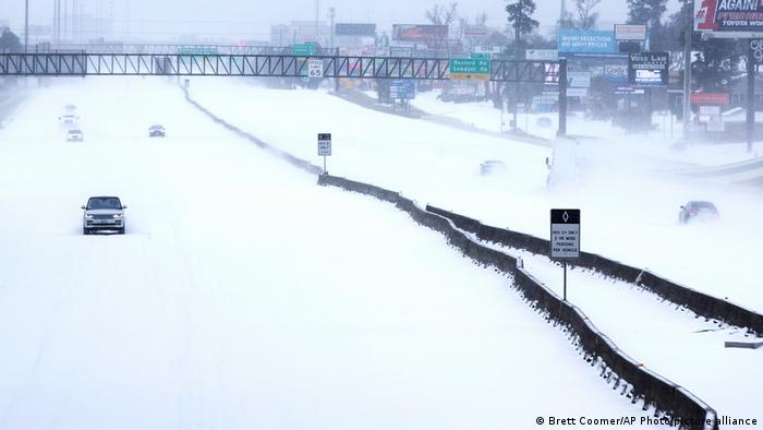 Cars driving along a snowy highway in Texas