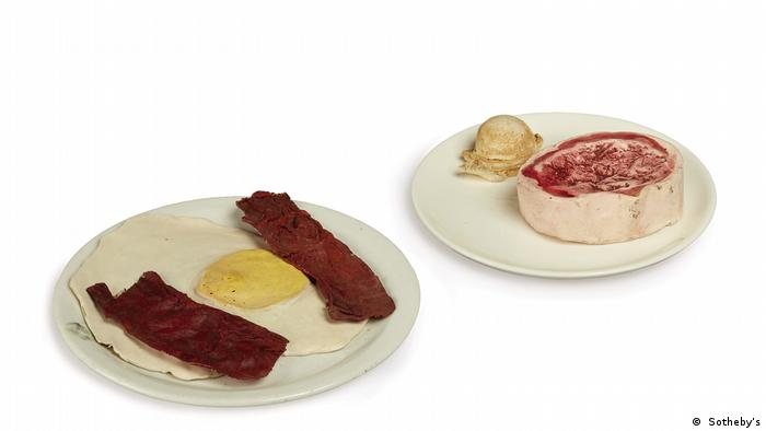 Two plates with bacon and eggs, ice cream and beef steak.