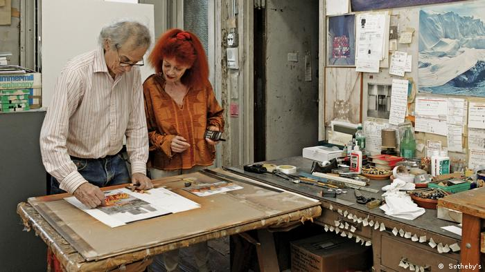 Christo and Jeanne-Claude at a worktable in their New York atelier