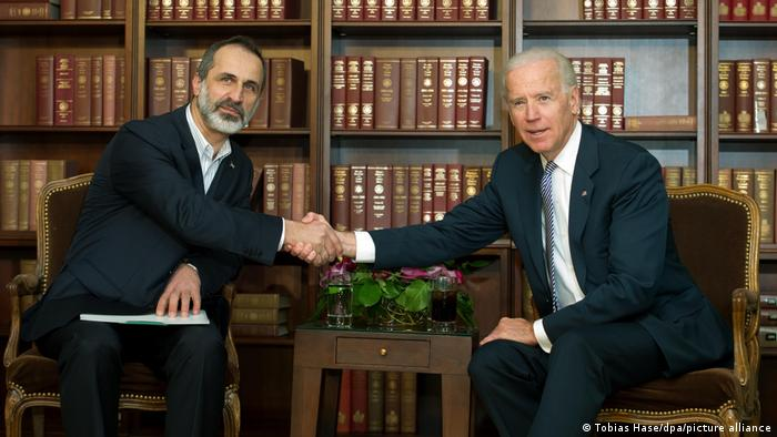 Joe Biden shaking hands with Syrian opposition leader Moaz al-Khatib