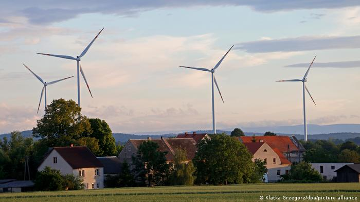 Wind turbines next to a village in Poland