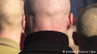 The backs of three skinheads