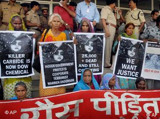 Survivors holding posters as they waited for the verdict in the premises of Bhopal court