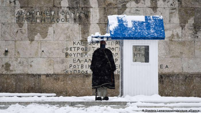 A Greek presidential guard standing in the snow