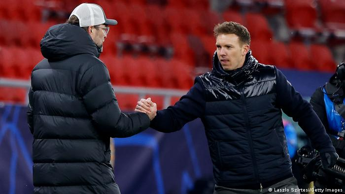 Jürgen Klopp and Julian Nagelsmann shake hands in Budapest before Liverpool vs RB Leipzig in the UEFA Champions League.