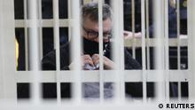 Viktor Babariko, former head of Belgazprombank and challenger in the 2020 presidential election, who was jailed on corruption charges, makes a hand heart gesture inside a defendants' cage before a court hearing in Minsk, Belarus February 17, 2021. Oxana Manchuk/BelTA/Handout via REUTERS ATTENTION EDITORS - THIS IMAGE HAS BEEN SUPPLIED BY A THIRD PARTY. NO RESALES. NO ARCHIVES. MANDATORY CREDIT.