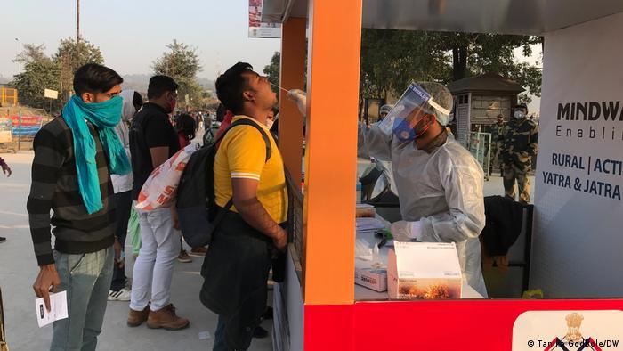 Visitors receive coronavirus tests before entering the Kumbh Mela celebration in Haridwar