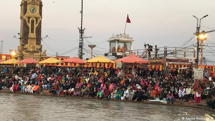Participants gather along the Ganges River at the Kumbh Mela festival in Haridwar