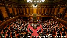 Italy's Prime Minister Mario Draghi addresses the Senate in Rome Wednesday, Feb. 17, 2021, before submitting his government to a vote of confidence. (Alberto Pizzoli/POOL photo via AP)