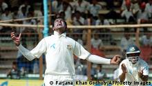 Bangladeshi cricketer Sakib Al Hasan (L) and Rajin Saleh (R) celebrates after the dismissal of unseen New Zealand batsman Aaron Redmond during the second day of first Test match between Bangladesh and New Zealand at The Chittagong Divisional Stadium in Chittagong on October 18, 2008. New Zealand have scored 52 runs for the loss of four wickets at the tea interval as they chase the Bangladesh first innings total of 245 runs. AFP PHOTO/Farjana KHAN GODHULY (Photo credit should read Farjana KHAN GODHULY/AFP via Getty Images)