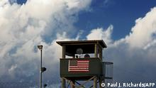 (FILES)In this photo reviewed by US military officials, a member of the US military mans one of the guard posts at sunrise at Camp Delta, part of the US Detention Center in Guantanamo Bay, Cuba, on March 30, 2010. - US President Joe Biden wants to close the Guantanamo Bay prison for terror suspects before the end of his term, the White House said February 12,2021, echoing an unfulfilled campaign promise from Barack Obama's administration. Asked at a press conference about a possible closure of the prison in Cuba during Biden's tenure, spokeswoman Jen Psaki said, That certainly is our goal and our intention. (Photo by Paul J. RICHARDS / AFP)