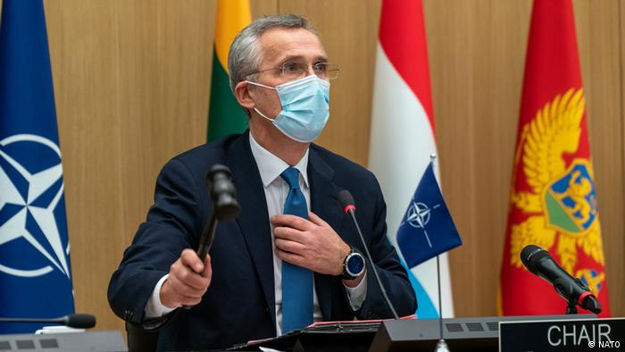 Jens Stoltenberg, NATO Secretary-General, wields his gravel at the Brussels conference of NATO defence ministers