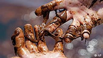 oily hands from spill in the gulf of mexico