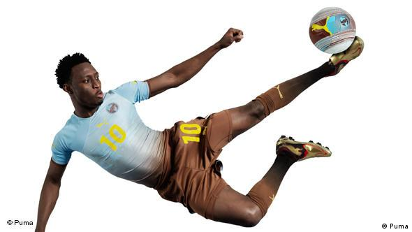 Nigeria's Chinedu Obasi performs an acrobatic kick while wearing the Puma Africa Unity Kit