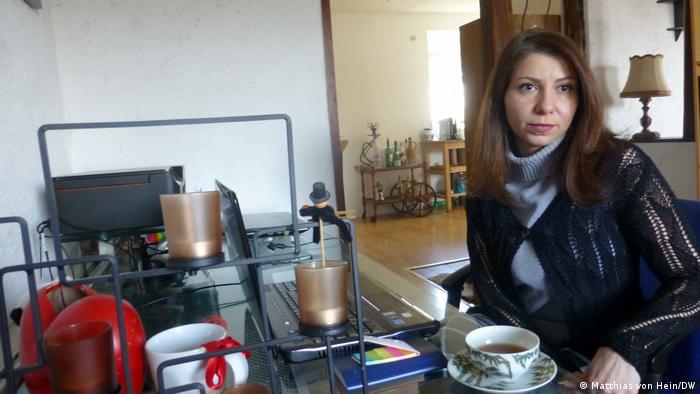 Luna Watfa drinking tea in her home