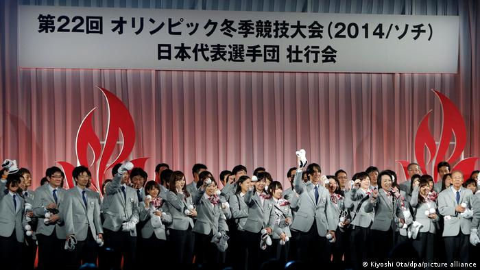 The Japanese delegation for the Sochi Olympics Seiko Hashimoto (in front of a microphone) cheers with members of the delegation during a send-off ceremony for the Sochi Olympics in Tokyo, Japan, 20 January 2014.