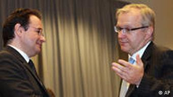 EU Commissioner for Economic Affairs Olli Rehn, right, and Greek Finance Minister George Papaconstantinou