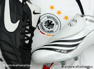 Adidas and Nike soccer shoes on a German national jersey
