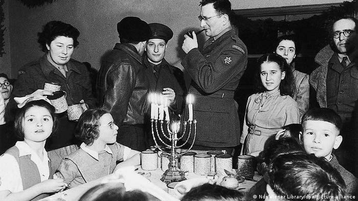 Surviving Jews holding a Hanukkah celebration in the immediate postwar period at a displaced persons' camp, on the site of the former Bergen-Belsen concentration camp
