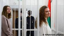Journalists Katsiaryna Andreyeva, right, and Daria Chultsova stand inside a defendants' cage in a court room in Minsk, Belarus, Thursday, Feb. 18, 2021. A court in Belarus on Thursday sent two female journalists to prison for years on charges of violating public order after they covered a protest against the nation's authoritarian president. The court in the Belarusian capital of Minsk on Thursday handed two-year sentences to Katsiaryna Andreyeva and Daria Chultsova of the Belsat TV channel. (AP Photo)
