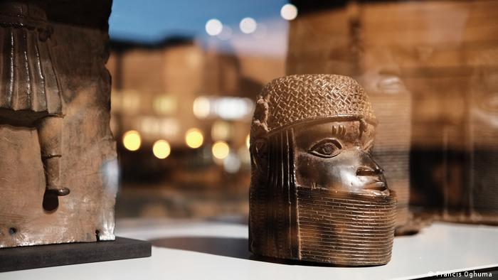 Benin bronze sculptures in a museum showcase