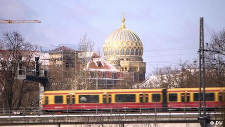 Berlin's Neue Synagoge in the background with a passing train in the foreground