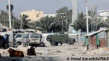 An armoured personnel carrier (APC) drives on a sealed off street to prevent a protest over delayed elections in Mogadishu, Somalia February 19, 2021. REUTERS/Feisal Omar