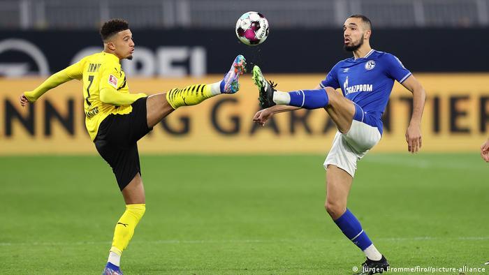 Dortmunds Jadon Sancho and Schalke's Nabil Bentaleb battle for the ball