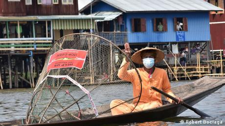 Myanmar protester on boat in Inle