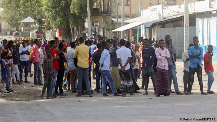 A crowd of Somalis gathers on a street in Mogadishu.