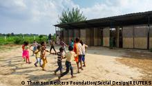 Children play in front of their ModSkool building. The low-cost school for migrant workers' children in Delhi, India, designed by Social Design Collaborative, incorporates local materials such as bamboo and dried grass, and can be easily erected and dismantled in the event of an eviction. Pictures via Thomson Reuters Foundation/Social Design Collaborative Suryan/Dang