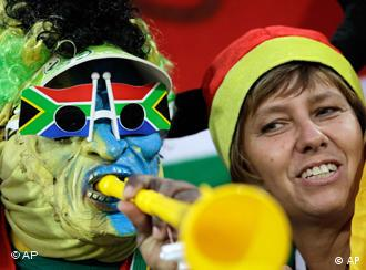 A fan blows a vuvuzela at a training session of the German national team in South Africa