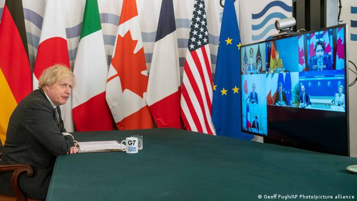 UK Prime Minister Boris Johnson steals a moment to look away during a virtual meeting of G7 world leaders