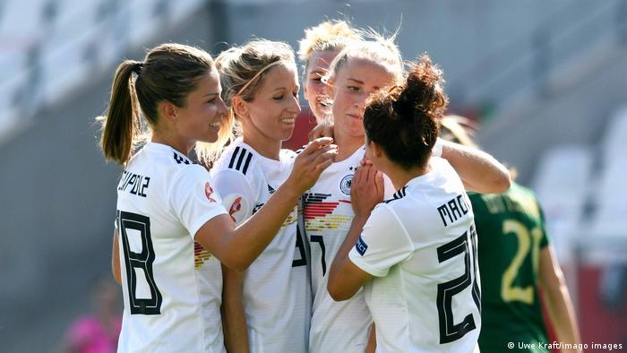 Germany's women's team celebrate together during a 2019 World Cup game