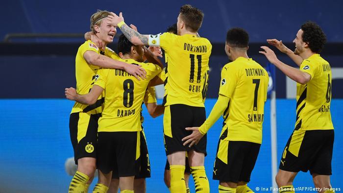 Borussia Dortmund's players celebrate Erling Haaland's brilliant goal against Schalke