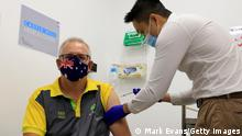 SYDNEY, AUSTRALIA - FEBRUARY 21: Australian Prime Minister Scott Morrison receives a Covid-19 vaccination from Doctor Jesse Li at Castle Hill Medical Centre on February 21, 2021 in Sydney, Australia. The Australian Covid-19 vaccination officially begins on Monday, with high-risk people and workers to receive the Pfizer vaccine. (Photo by Mark Evans/Getty Images)