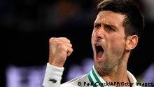 Serbia's Novak Djokovic celebrates a point against Russia's Daniil Medvedev during their men's singles final match on day fourteen of the Australian Open tennis tournament in Melbourne on February 21, 2021. (Photo by Paul CROCK / AFP) / -- IMAGE RESTRICTED TO EDITORIAL USE - STRICTLY NO COMMERCIAL USE -- (Photo by PAUL CROCK/AFP via Getty Images)