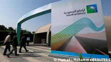 03.11.2019 FILE PHOTO: The logo of Aramco is seen as security personnel walk before the start of a press conference by Aramco at the Plaza Conference Center in Dhahran, Saudi Arabia November 3, 2019. REUTERS/Hamad I Mohammed/File Photo