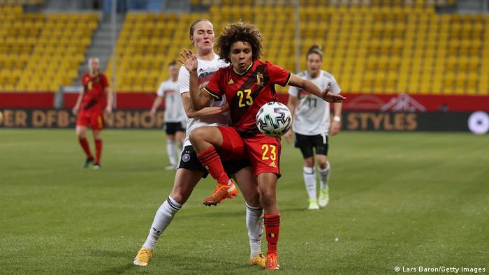 Belgium's Kassandra Missipo fends off Germany's Sydney Lohmann in the friendly in Aachen